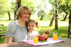Mother and daughter picnic Stock Photos