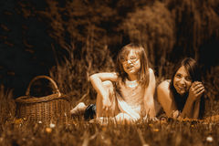 Mother and daughter on picnic. Summer leisure. Royalty Free Stock Image