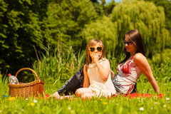 Mother and daughter on picnic. Summer leisure. Royalty Free Stock Images