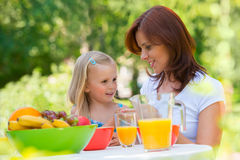 Mother and daughter picnicking Stock Image