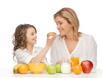 Mother and daughter. Picture of mother and daughter with healthy breakfast Royalty Free Stock Photos