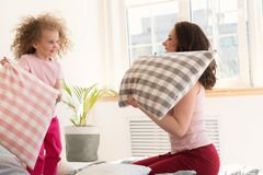 Mother and daughter. Pillow fight Royalty Free Stock Photo
