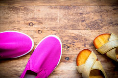 Mother and Daughter pink shoes on wooden background, Mothers Day Royalty Free Stock Photos