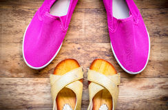 Mother and Daughter pink shoes on wooden background, Mothers Day Stock Images