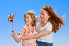 Mother and daughter with pinwheel Royalty Free Stock Photo