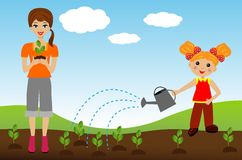 Mother with daughter plant nursery transplant in soil Stock Images