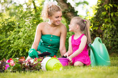 Mother and daughter planting flowers together Stock Image