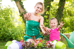 Mother and daughter planting flowers together Royalty Free Stock Photo