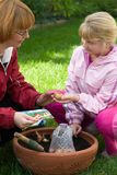 Mother and daughter planting t Stock Photography