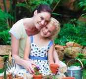 Mother and daughter planting in their garden Royalty Free Stock Image