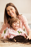 Mother and Daughter Planting Stock Photography