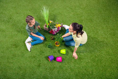 Mother and daughter with plants and flowerpots Royalty Free Stock Images