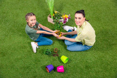 Mother and daughter with plants and flowerpots Royalty Free Stock Photo