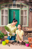 Mother and daughter with plants and flowerpots standing Stock Image
