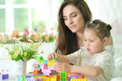 Mother and daughter with plastic blocks Royalty Free Stock Photos