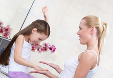 Mother and daughter play in bathroom royalty free stock photography