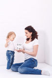 Mother and daughter play with dice Stock Photos