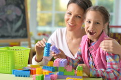 Mother and daughter play lego stock image