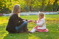Mother and daughter play in the park Royalty Free Stock Images