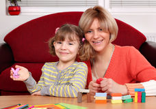 Mother and daughter play with plasticine Royalty Free Stock Image