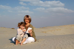 Mother and daughter play with tablet Stock Image
