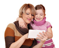 Mother and daughter play with tablet pc Royalty Free Stock Photo