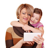 Mother and daughter play with tablet pc Royalty Free Stock Images