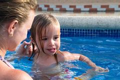 Mother and Daughter Playful in the Pool Stock Images
