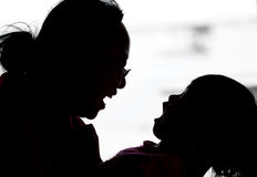 Mother and daughter playful silhoutte. Playful mother and daughter silhoutte Stock Photos