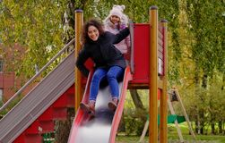 Mother and daughter on a playground.  Royalty Free Stock Image