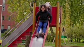 Mother and daughter on a playground.  stock footage