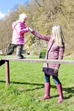 Mother and daughter at playground Stock Images