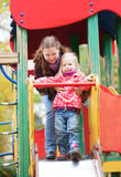 Mother and daughter on playground Stock Photography
