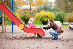 Mother and daughter on playground Royalty Free Stock Photos