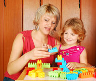Mother and daughter playing. With toy blocks Stock Photography