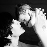 Mother and daughter playing. A mother playing with her little baby Royalty Free Stock Images