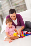 Mother daughter playing Stock Images
