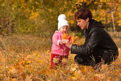 Mother and daughter playing in autumn Royalty Free Stock Images