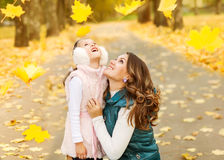 Mother and daughter playing in autumn park Royalty Free Stock Images