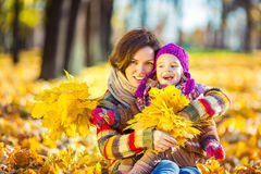 Mother and daughter in playing in autumn park Royalty Free Stock Images