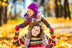 Mother and daughter playing in autumn park Royalty Free Stock Photo