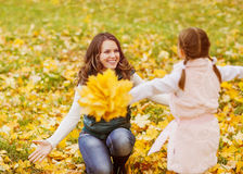 Mother and daughter playing in autumn park Stock Photography