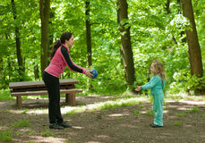 Mother and daughter playing ball outdoor Stock Photo