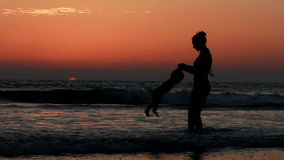 Mother and daughter. Mother and  daughter playing on the beach stock video footage