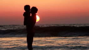 Mother and daughter. Mother and  daughter playing on the beach stock footage