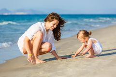 Mother and daughter playing on the beach Royalty Free Stock Photo