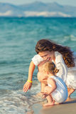 Mother and daughter playing on the beach Royalty Free Stock Photography