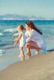 Mother and daughter playing on the beach Royalty Free Stock Images