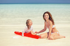 Mother and daughter playing on the beach Royalty Free Stock Image