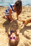 Mother and daughter playing on beach. royalty free stock images